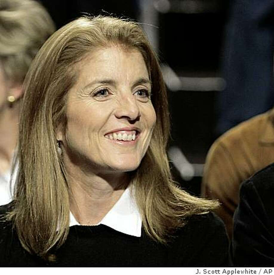 ** FILE ** In this Wednesday, Oct. 15, 2008 file photo, Caroline Kennedy, left, sits with husband Ed Schlossberg, before the start of the a presidential debate at Hofstra University in Hempstead, N.Y. A person close to the discussions says Kennedy will seek the U.S. Senate seat being vacated by Hillary Clinton. Kennedy has told Democratic Gov. David Paterson she wants the job should Clinton be confirmed as secretary of state for President-elect Barack Obama. (AP Photo/J. Scott Applewhite, File) Photo: J. Scott Applewhite, AP