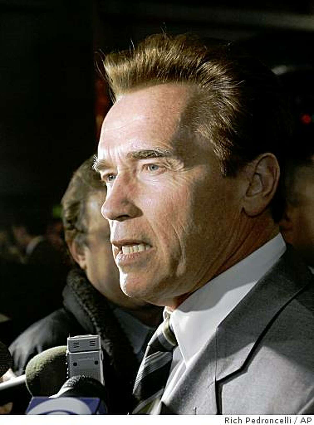 Gov. Arnold Schwarzenegger said that he was sad that California would lose jobs and halt projects while commenting on a state panel's decision to stop financing nearly all infrastructure projects, while talking to reporters in Sacramento, Calif., Wednesday, Dec. 17, 2008. The three-member Pooled Money Investment Board voted 3-0 not to lend money for an estimated 2,000 infrastructure projects statewide, through June, halting nearly $4 billion in loans for everything from freeway interchanges to classrooms.(AP Photo/Rich Pedroncelli)