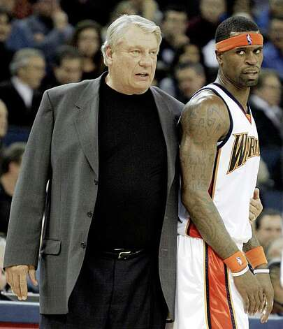 Golden State Warriors coach Don Nelson, left, restrains Stephen Jackson after a technical foul was called against Jackson during the first half against the Milwaukee Bucks. Photo: Ben Margot, AP
