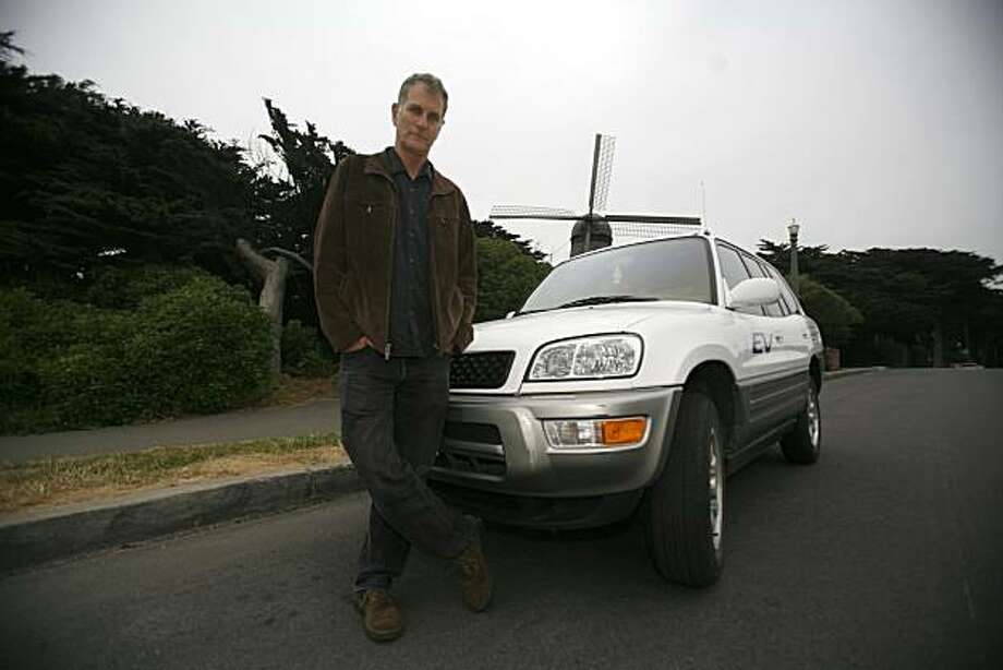 Marc Geller poses with his ten-year old Rav4, Toyota's electric car, on Friday July 23, 2010 in San Francisco, Calif. Toyota recently announced that it would team up with Tesla to release newer versions of the Rav4 models already released from 1997 to 2003. Photo: Jasna Hodzic, The Chronicle