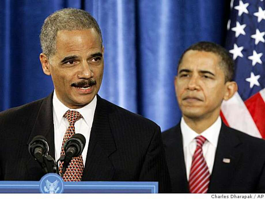 ** FILE ** In this Dec. 1, 2008, file photo, Attorney General-designate Eric Holder speaks during a news conference with President-elect Barack Obama, right,  in Chicago. Holder may have to consider removing himself from overseeing the Chicago corruption probe that ensnared Illinois Gov. Rod Blagojevich, legal experts say. Holder was a co-chairman of Barack Obama's presidential campaign, joining it in 2007 when the long-running, high-profile Chicago investigation focused on a businessman who had been among the biggest fundraisers for Obama and Blagojevich. (AP Photo/Charles Dharapak) Photo: Charles Dharapak, AP