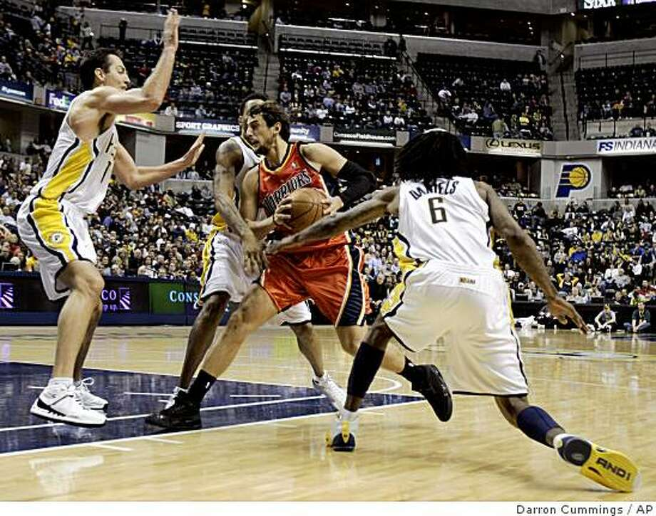 Golden State Warriors guard Marco Belinelli, of Italy,  is defended by Indiana Pacers forward Jeff Foster, left, guard Brandon Rush and guard Marquis Daniels (6) as he drives to the basket during the fourth quarter of an NBA basketball game in Indianapolis, Wednesday, Dec. 17, 2008. Indiana won 127-120. (AP Photo/Darron Cummings) Photo: Darron Cummings, AP