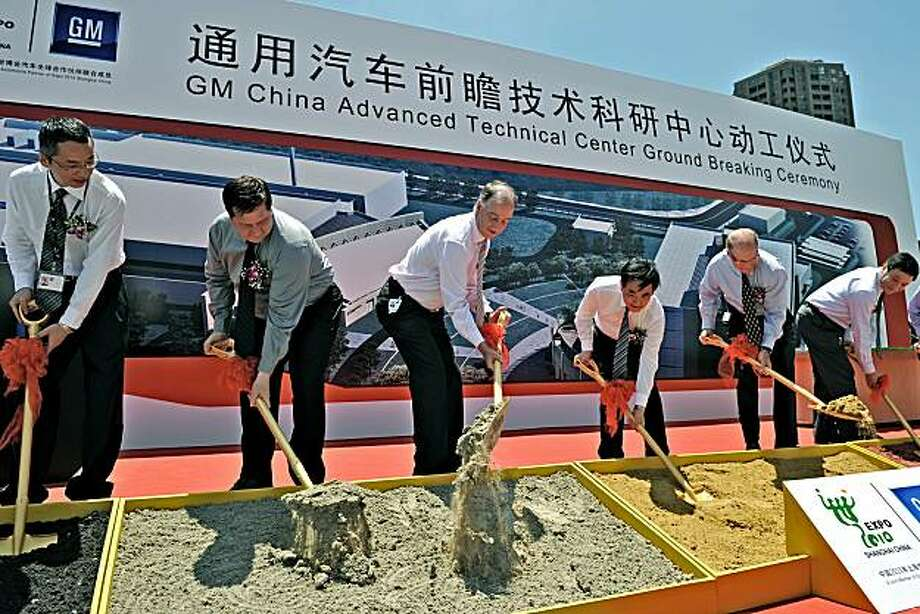 US automaker General Motors' president and managing director for China operations, Kevin Wale (3rd L) takes part in the groundbreaking ceremony of the company's advanced technical center in Shanghai on June 19, 2010.  US auto giant broke ground in Shanghai on a new research facility that will develop electric car, lightweight material and alternative fuel technology for China and the world. Photo: Philippe Lopez, AFP/Getty Images
