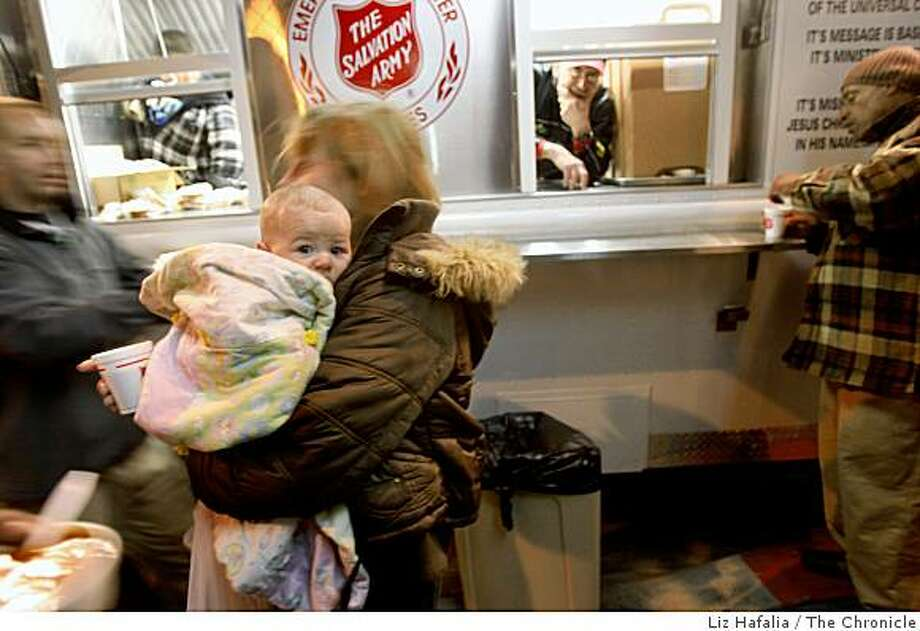 Vinetta Boice has a cup of coffee from the Salvation Army while carrying her 3 month old, Sydney, in San Francisco, in a file photo from 2008.. Photo: Liz Hafalia, The Chronicle