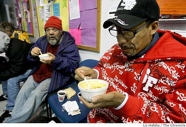 Ladoris Perkins (right) and Poncho (left) eat soup from the Salvation Army on Golden Gate at Leavenworth streets in San Francisco, Calif, on Friday, December 12, 2008. Photo: Liz Hafalia, The Chronicle