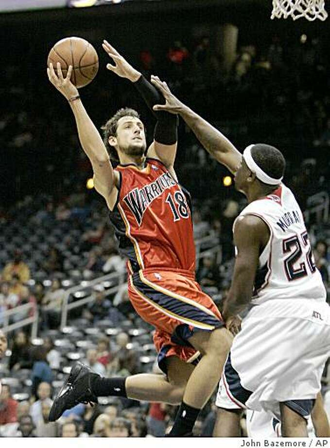 Golden State Warriors' Marco Belinelli, (18), of Italy, drives to the basket as Atlanta Hawks' Ronald Murray defends in the fourth quarter of an NBA basketball game Friday, Dec. 19, 2008, in Atlanta.  (AP Photo/John Bazemore) Photo: John Bazemore, AP