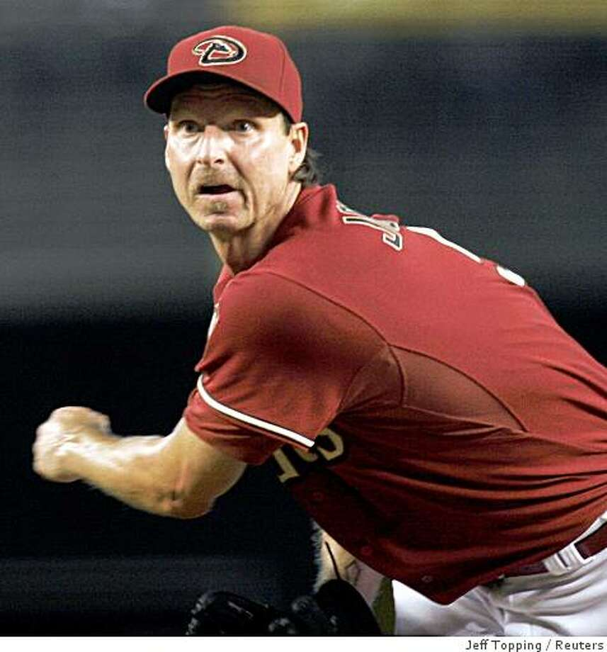 Ran on: 07-25-2007 Randy Johnson acknowledged he might not return this season, or at all, depending on his back. Ran on: 07-25-2007 Photo: Jeff Topping, Reuters