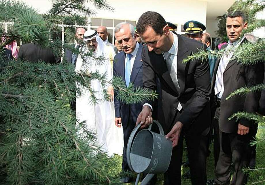 A handout picture released by the Lebanese photo agency Dalati and Nohra shows Syrian President Bashar al-Assad planting a Cedar tree in the garden of the presidential palace of Baabda, east of Beirut on July 30, 2010 during an official visit. Photo: -, AFP/Getty Images
