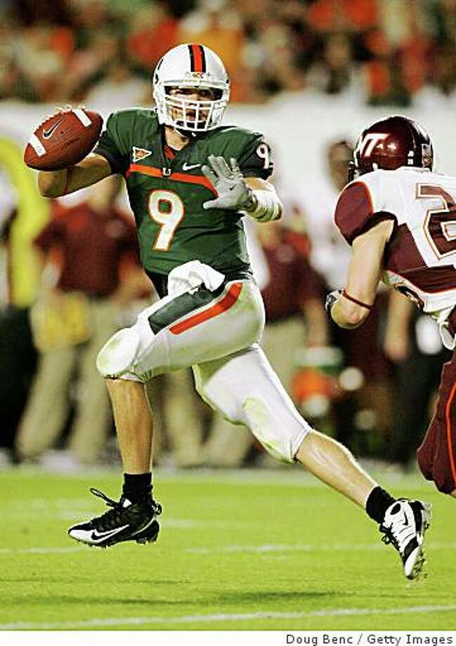 Miami quarterback Robert Marve scrambles away from linebacker Cody Grimm #26 of the Virginia Tech Hokies at Dolphin Stadium on November 13, 2008 in Miami. Photo: Doug Benc, Getty Images