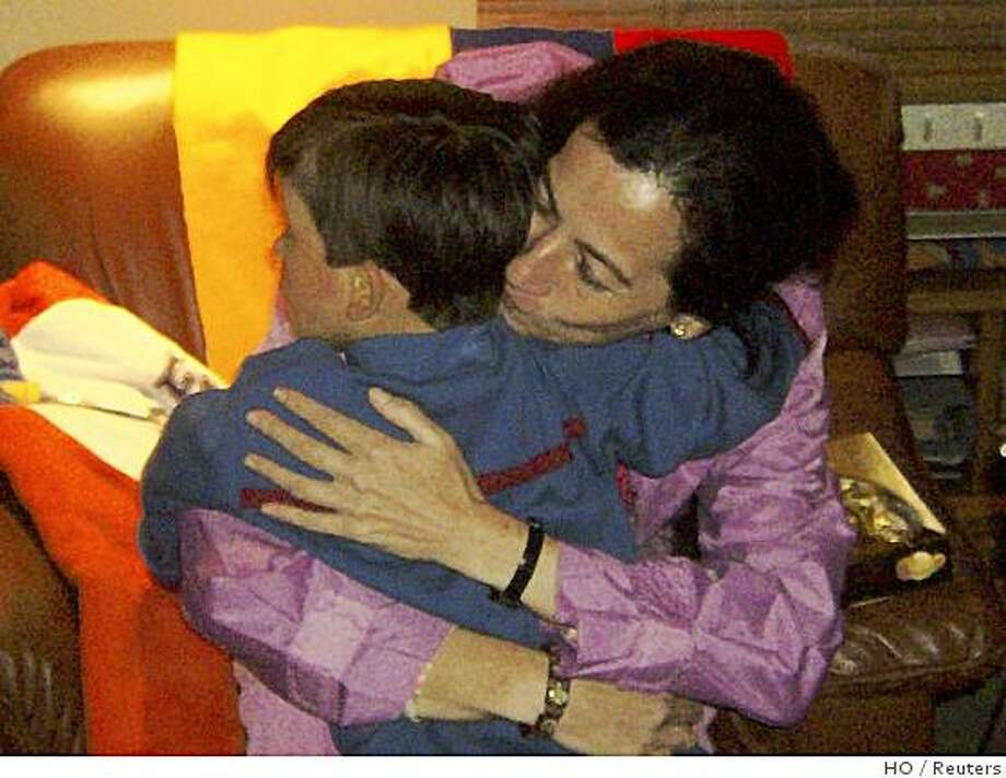 Colombian politician Clara Rojas embraces her son Emmanuel at a foster center in Bogota January 13, 2008. The Revolutionary Armed Forces of Colombia, or FARC, rebels on January 10 freed Colombian politicians Rojas and Consuelo Gonzalez who were held for years in secret jungle camps. Emmanuel, born in captivity, is under Colombian child welfare office custody. BEST QUALITY AVAILABLE   REUTERS/ICBF/Handout (COLOMBIA).  EDITORIAL USE ONLY. NOT FOR SALE FOR MARKETING OR ADVERTISING CAMPAIGNS. Photo: HO, Reuters