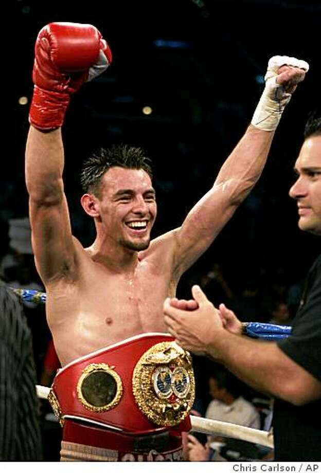 : Robert Guerrero reacts after winning his bout against Eric Aiken in the eight round of their IBF featherweight championship boxing match in Los Angeles, Saturday, Sept. 2, 2006.  (AP Photo/Chris Carlson)Ran on: 09-18-2006Robert Guerrero will next fight Nov. 4 to defend his featherweight championship belt. Robert Guerrero reacts after winning his bout against Eric Aiken in the eight round of their IBF featherweight championship boxing match in Los Angeles, Saturday, Sept. 2, 2006. (AP Photo/Chris Carlson) Ran on: 09-18- Photo: Chris Carlson, AP