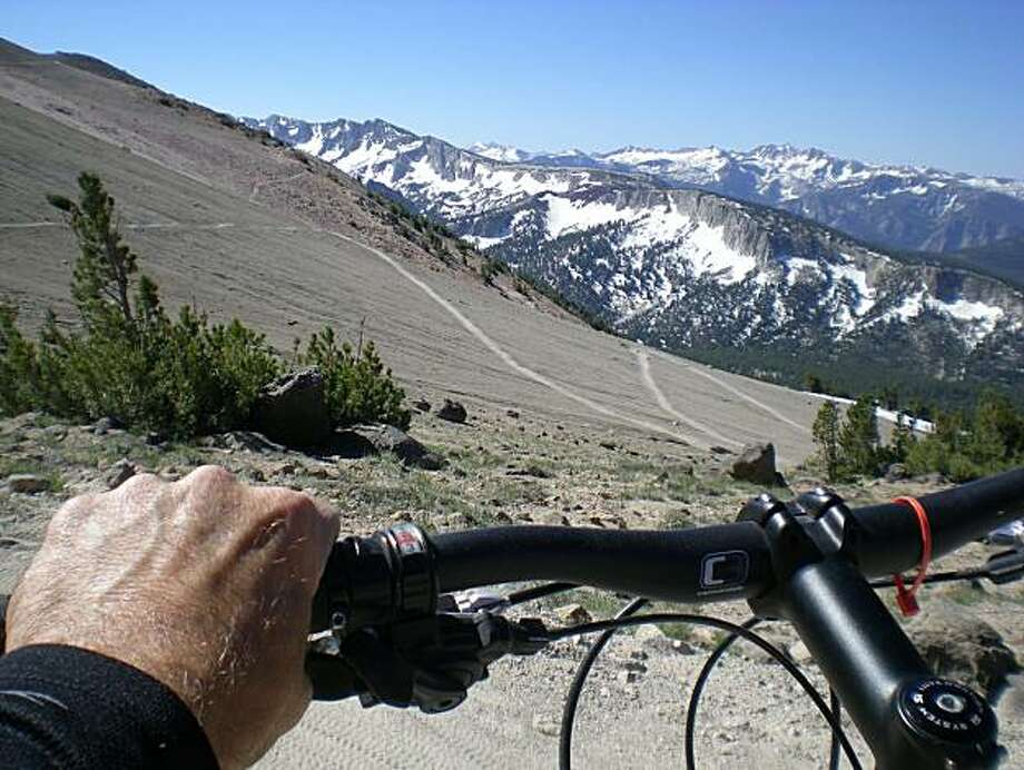 """During Mammoth, California's midsummer days, with snow skis finally put away, the entire ski slope has become a mountain bike park. Cyclists plunge down the """"Off the Top"""" and """"Kamikaze"""" trails. An eight-mile descent over volcanic slopes, through cool forests and down to the center of town. Photo: Steve Rubenstein, Special To The Chronicle"""