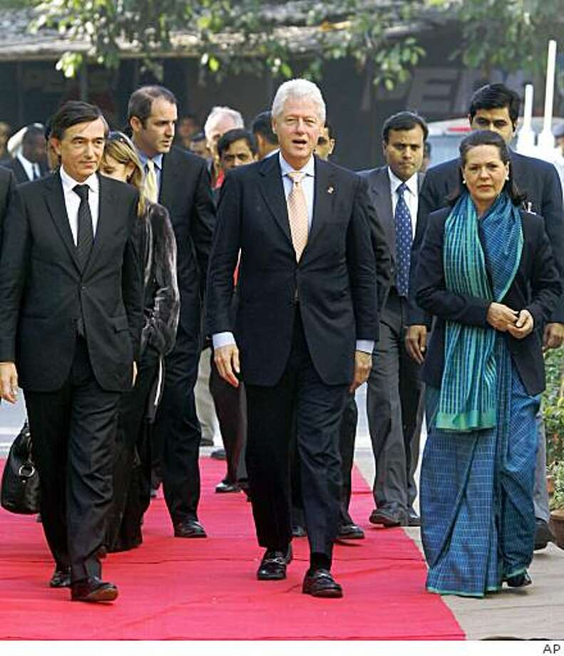 ** FILE ** In this  Nov. 30, 2006, file photo former U.S. President Bill Clinton, center, arrives to inaugurate the National Pediatric HIV/AIDS Initiative along with Indian Congress Party President Sonia Gandhi, right, and  French Foreign Minister Philippe Douste-Blazy in New Delhi, India.  The Clinton Foundation disclosed the names of its 205,000 donors on a Web site Thursday, Dec. 18, 2008, ending a decade of resistance to identifying the sources of its money. Bill Clinton agreed to release the information after concerns emerged that his extensive international fundraising and business deals could conflict with America's interests if his wife became Obama's top diplomat.  (AP Photo) Photo: AP
