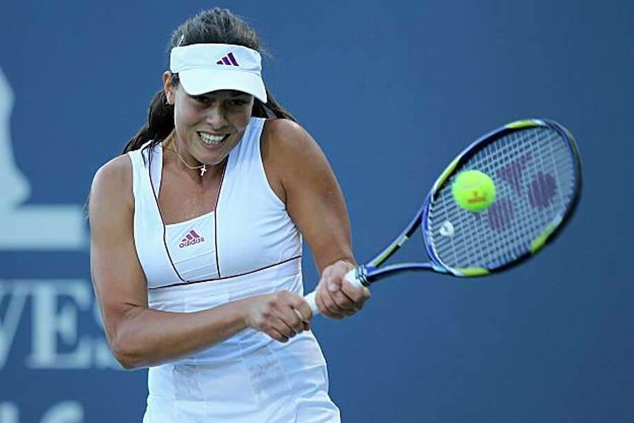 STANFORD, CA - JULY 26:  Ana Ivanovic of Serbia returns a shot against Alisa Kleybanova of Russia during Day 1 of the Bank of the West Classic at Stanford University on July 26, 2010 in Stanford, California. Photo: Jed Jacobsohn, Getty Images