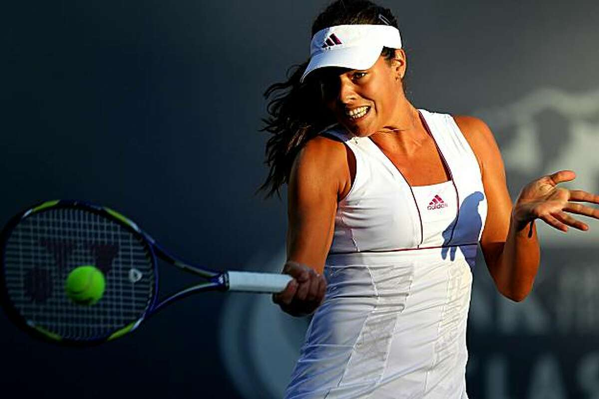 STANFORD, CA - JULY 26: Ana Ivanovic of Serbia returns a shot against Alisa Kleybanova of Russia during Day 1 of the Bank of the West Classic at Stanford University on July 26, 2010 in Stanford, California.