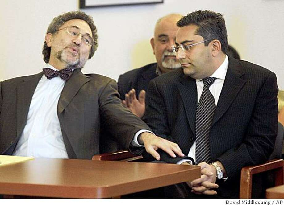 Defense attorney M. Gerald Schwartzbach, left, reacts with relief to the unanimous not guilty jury verdict and pats his client's arm Dr. Hootan Roozrokh. Roozrokh was accused of endangering the health of 25-year-old Ruben Navarro by attempting to hasten his death during a failed organ removal by ordering large amounts of painkillers. He was charged with felony dependent adult abuse in connection with the attempted organ removal at Sierra Vista Regional Medical Center in San Luis Obispo. (AP Photo/The tribune,David Middlecamp) Photo: David Middlecamp, AP