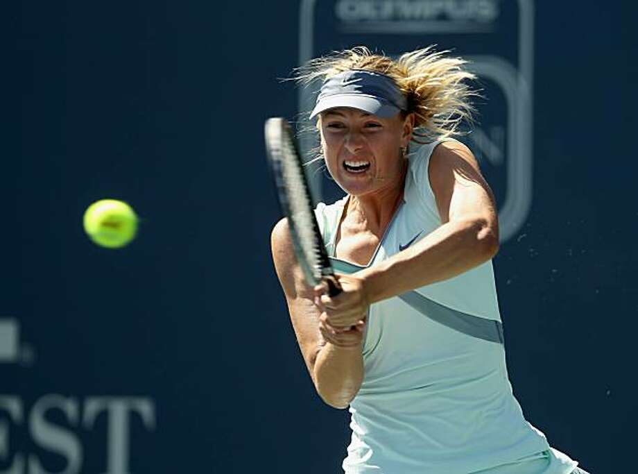 STANFORD, CA - JULY 29:  Maria Sharapova of Russia returns the ball to Olga Govortsova of Belarus during Day 4 of the Bank of the West Classic at Stanford University on July 29, 2010 in Stanford, California. Photo: Ezra Shaw, Getty Images