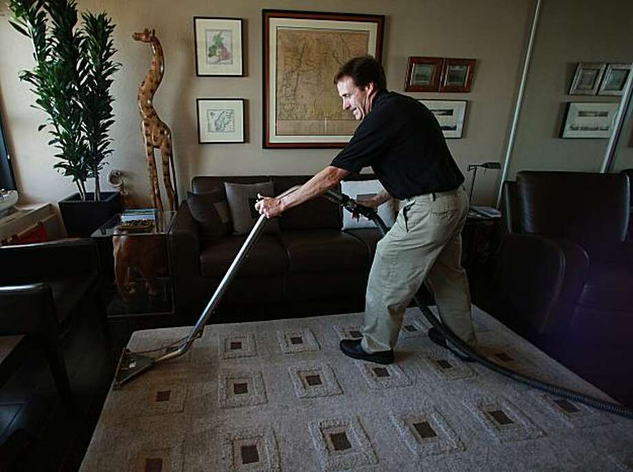 Larry Lynch, past drummer for the Greg Kihn Band from 1976 to 1984, cleaning a carpet for one of his clients in Emeryville, Calif., on Monday, July 19, 2010.  His business is called Larry's Extreme Clean. Photo: Liz Hafalia, The Chronicle