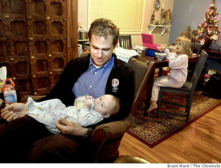Father Mike Hochleutner, left, feeds Nolan while Sofia eats her dinner at the family home. A special intensive care nursery at UCSF focuses on identifying and early treatment of brain damage in newborns. Nolan Hochleutner, 3 months, is such an infant. He lives at home in Saratoga with his parents and sister Sofia Wednesday December 10, 2008. Photo: Brant Ward, The Chronicle
