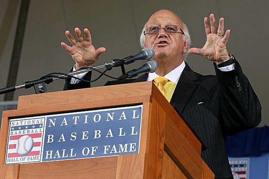 Jon Miller gives his speech after he received the Ford C. Frick award for contributions in baseball broadcasting at Clark Sports Center during the Baseball Hall of Fame induction ceremony Sunday in Cooperstown, N.Y. Photo: Jim McIsaac, Getty Images