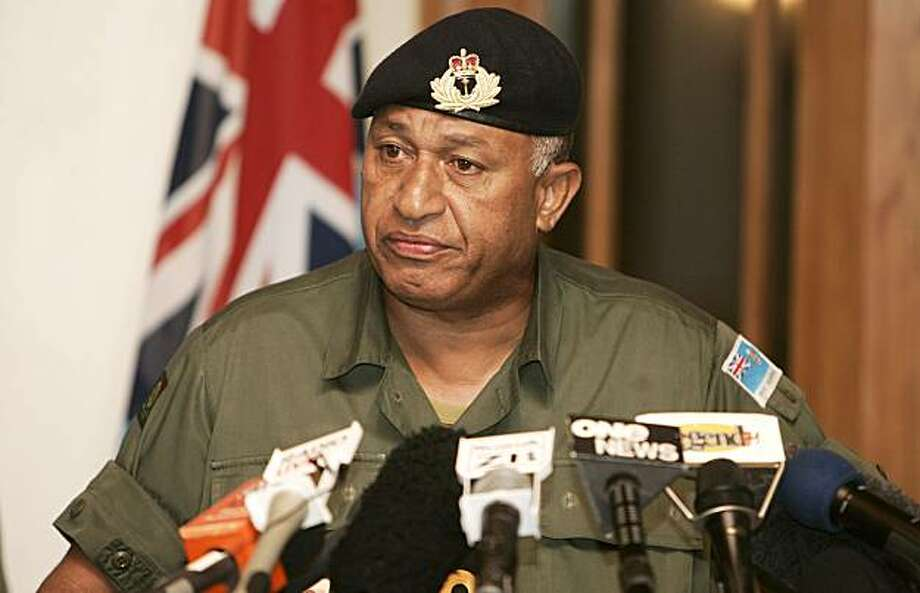 Fiji's military commander Frank Bainimarama announces he had taken control of the country from the elected government and appointed a new Prime Minister in Suva Tuesday, Dec. 5, 2006. Bainimarama said he had invoked special powers under the constitution to assume some powers of the president, and was using them to dismiss Prime Minister Laisenia Qarase from office and appoint an interim replacement. (AP Photo/Rick Rycroft) Photo: Rick Rycroft, AP