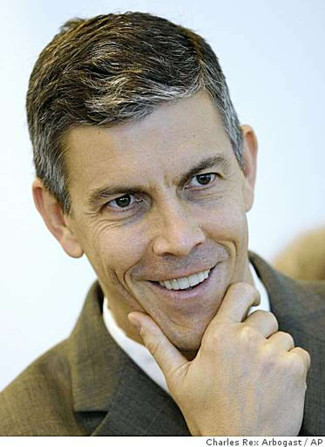 **FILE**A Nov. 13, 2008 file photo shows Chicago Public Schools chief Arne Duncan smiling during a news conference in Chicago. Considered a potential choice for education secretary in President-elect Barack Obama's Cabinet, Duncan visited with outgoing Education Secretary Margaret Spellings in Washington Thursday, Dec. 4, 2008, on what he said was a purely social call and had nothing to do with the possibility of being chosen education secretary. (AP Photo/Charles Rex Arbogast) Photo: Charles Rex Arbogast, AP