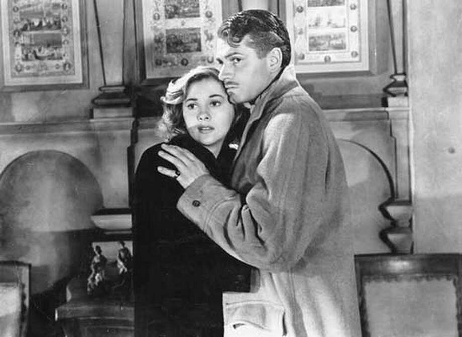 """""""Rebecca"""" (1940):When a naive young woman (Joan Fontaine) marries a rich widower (Laurence Olivier) and settles in his gigantic mansion, she finds the memory of the first wife maintaining a grip on her husband and the servants. Hitchcock's first American-made film was nominated in 11 Oscar categories and won Best Black and White Cinematography and Best Picture. It is his only film to win Best Picture."""