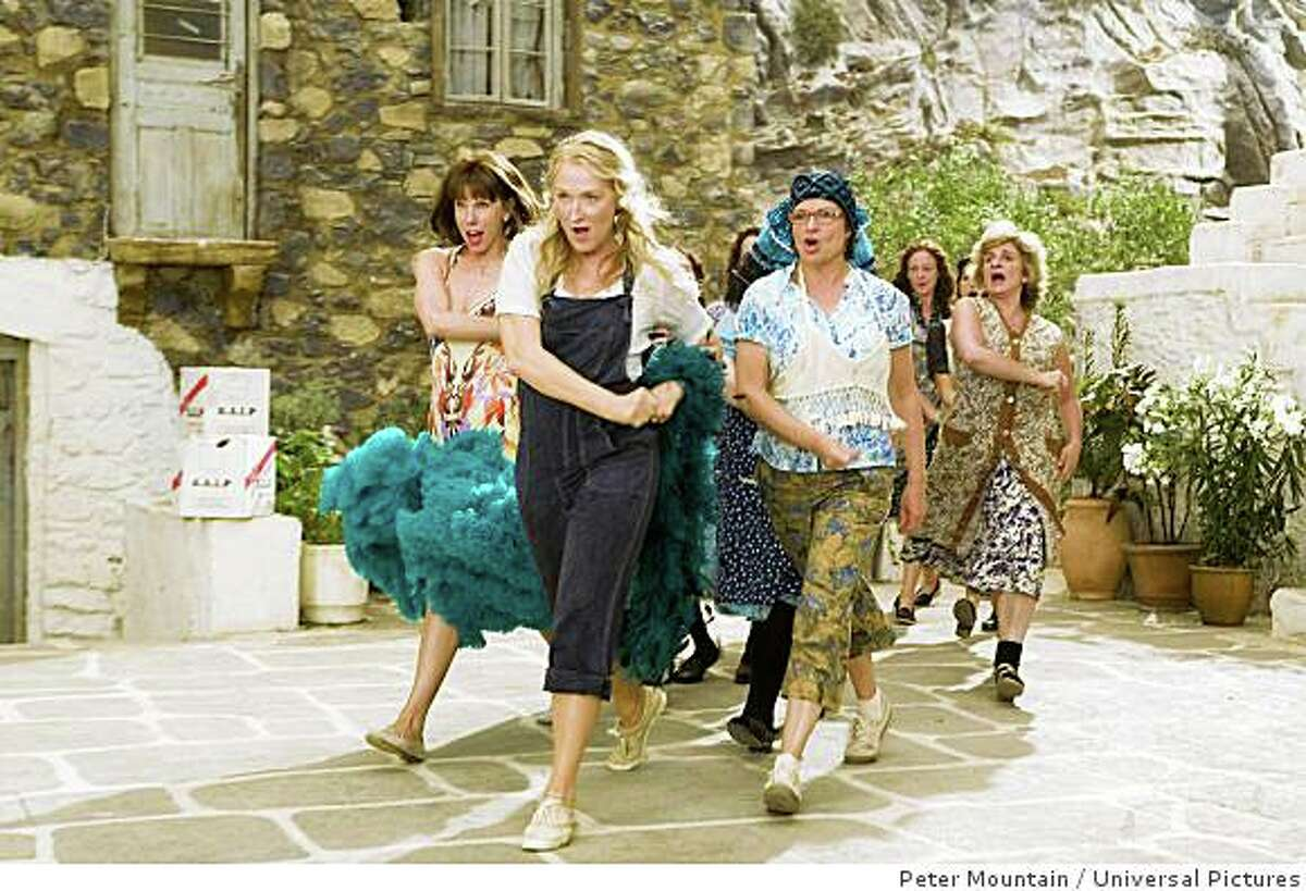 Donna and The Dynamos?'(L to R) Tanya Chesham-Leigh (CHRISTINE BARANSKI), Donna Sheridan (MERYL STREEP) and Rosie Rice (JULIE WALTERS)?'lead a Greek chorus in the musical romantic comedy Mamma Mia! Credit: Peter Mountain