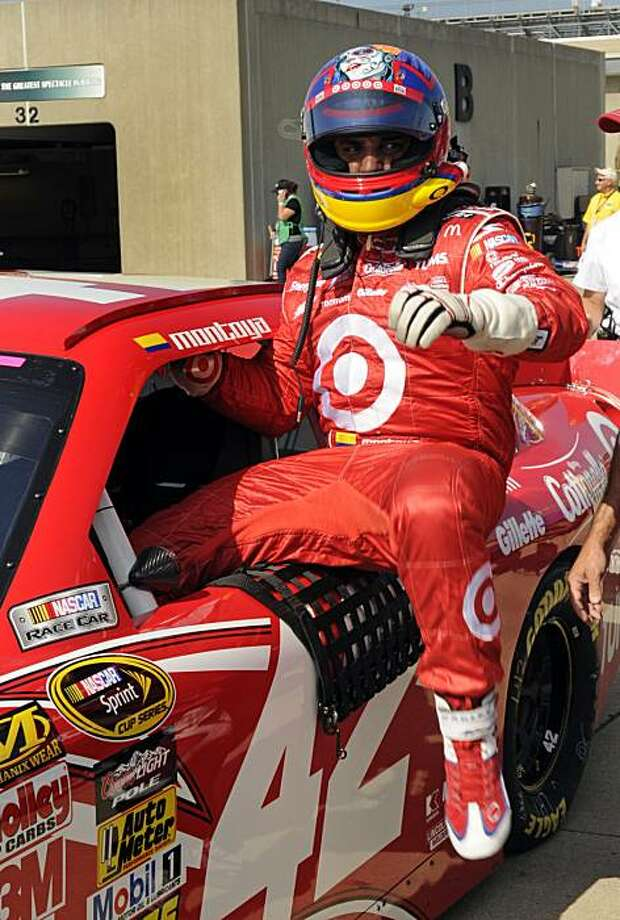 ** CORRECTS DATE ** Juan Pablo Montoya, of Colombia, climbs out of his car after he qualified for the NASCAR Brickyard 400 auto race at the Indianapolis Motor Speedway in Indianapolis, Saturday, July 24, 2010. Montoya qualified on the pole for the race. Photo: Tom Strickland, AP