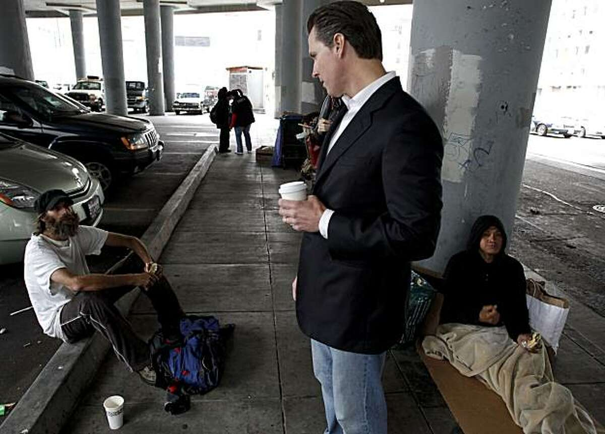 Mayor Newsom meets with a group of homeless camped out on the street under the transbay terminal. Mayor Gavin Newsom tours the Transbay Terminal in San Francisco, Ca. on Friday July 30, 2010, meeting with homeless who are in need of city services such as shelter, food and healthcare.