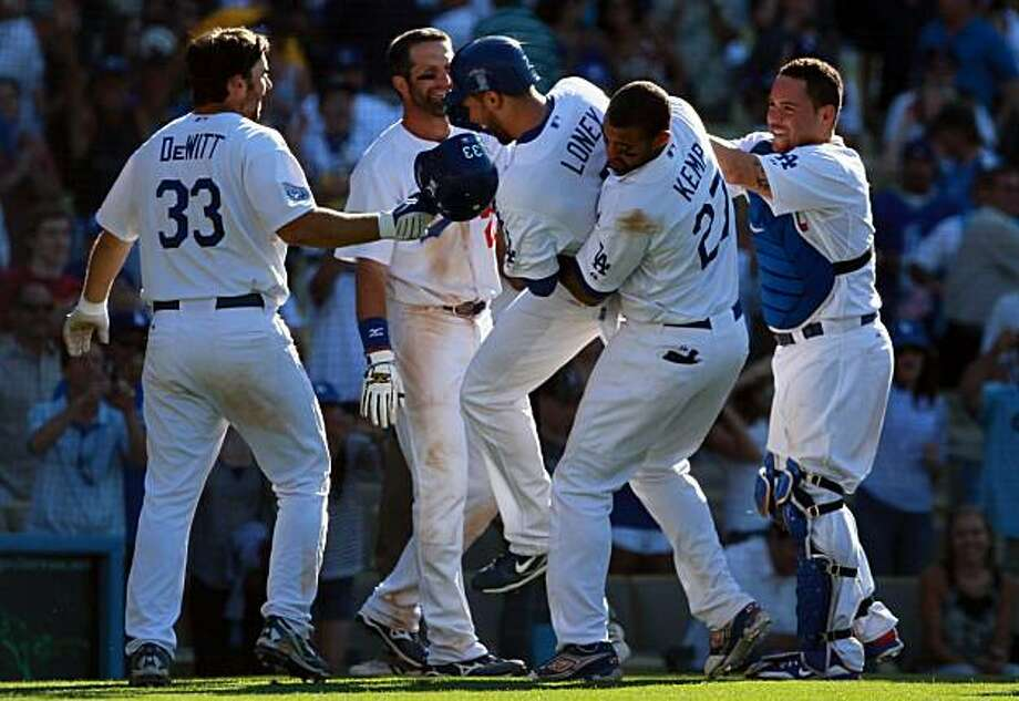 LOS ANGELES, CA - JULY 24:  (L-R) Blake DeWitt #33, Casey Blake #23, James Loney #7, Matt Kemp #27 and Russell Martin #55 of the Los Angeles Dodgers celebrate Loney's game winning walk-off homerun in the 13th inning against the New York Mets at Dodger Stadium on July 24, 2010 in Los Angeles, California. The Dodgers defeated the Mets 3-2 in 13 innings. Photo: Jeff Gross, Getty Images