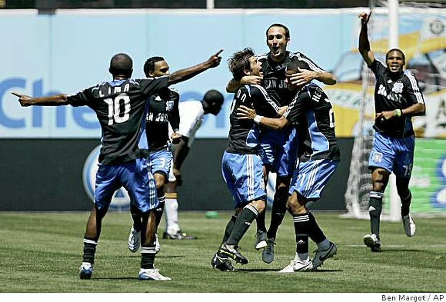 San Jose Earthquakes' Ryan Cochrane jumps into the arms of teammates Eric Denton, left, and Jason Hernandez after scoring the game-winning goal against the Los Angeles Galaxy in the final minutes of a soccer match Sunday, Aug. 3, 2008, in Oakland, Calif. The Earthquakes won 3-2. Photo: Ben Margot, AP