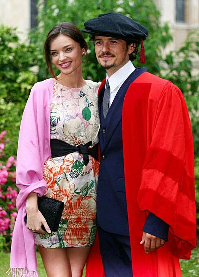 FILE - In this Tuesday July 13, 2010 picture, actor Orlando Bloom and model Miranda Kerr, pose for a photograph before he received an honorary degree from the University of Kent during a ceremony at Canterbury Cathedral in Canterbury, England. Bloom Kerr have married, her employer said Friday, July 23, 2010. (AP Photo/PA, Gareth Fuller)  UNITED KINGDOM OUT Photo: Gareth Fuller, AP