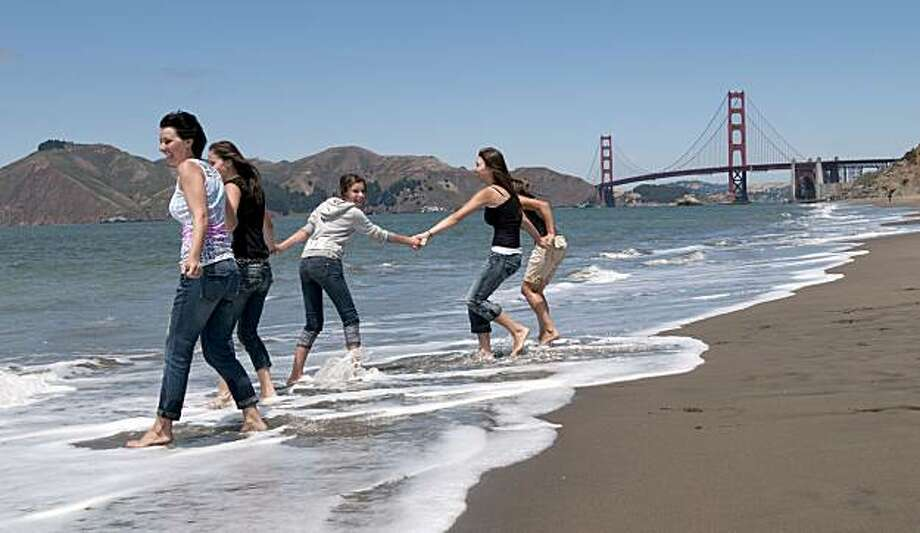 From left to right, Vera Getmanchuk, her niece Olga Orlov, daughter Jessica Getmanchuk, and nieces Alvina and Lana Orlov play in the water at Baker Beach.  A recent study indicates that the water quality of Baker Beach is poor and is photographed in San FFrom left to right, Vera Getmanchuk, her niece Olga Orlov, daughter Jessica Getmanchuk, and nieces Alvina and Lana Orlov play in the water at Baker Beach.  A recent study indicates that the water quality of Baker Beach is poor and is photographed in San Francisco, Calif., on Wednesday, July 28, 2010. Photo: Chad Ziemendorf, The Chronicle