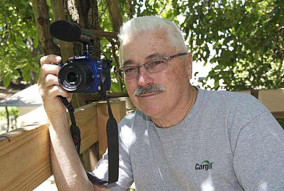 Photographer Bill Owens takes a self portrait in the tree house behind his hayward cottage. Photo: Bill Owens