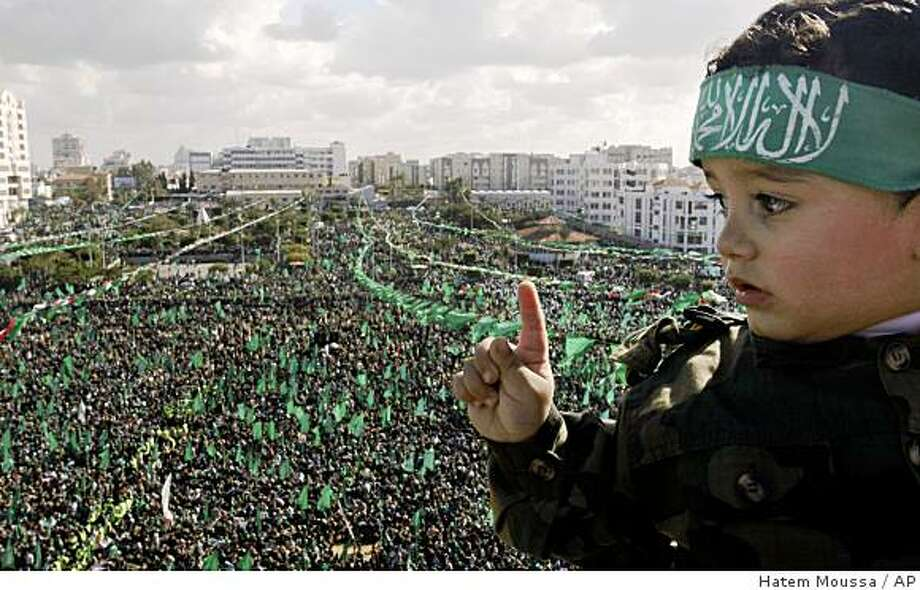 Palestinian supporters of the Hamas attend a rally in Gaza City, Sunday, Dec. 14, 2008. Some tens of thousands of Hamas supporters marked the Islamic militant group's 21st anniversary with an outdoor rally Sunday, and the show of strength included a play featuring a mock-captive Israeli soldier begging for his freedom. (AP Photo/Hatem Moussa) Photo: Hatem Moussa, AP