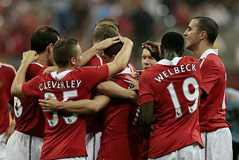 HOUSTON - JULY 28:  Manchester United celebrate a goal by Javier Hernandez #14 in his debut with the team during the MLS All Star Game at Reliant Stadium on July 28, 2010 in Houston, Texas. Photo: Bob Levey, Getty Images