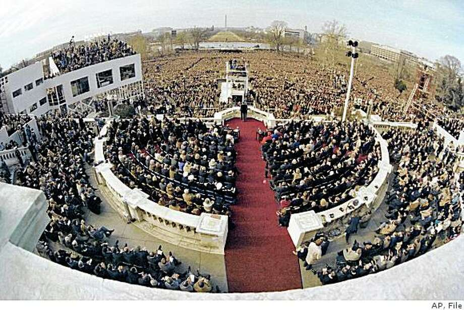 ** FILE ** In this Jan. 20, 1981 file photo, a wide angle view from the Capitol balcony shows President Ronald Reagan, visible at center, addressing the nation following his swearing-in ceremony in Washington. Federal and local authorities are preparing for record numbers of people crowding into the National Mall and the parade route for the inauguration of President-elect Barack Obama. (AP Photo, File) Photo: AP, File