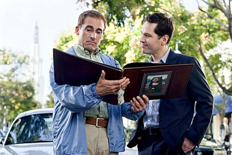 """In this film publicity image released by Paramount Pictures, Steve Carell, left, and Paul Rudd are shown in a scene from """"Dinner for Schmucks."""" Photo: Merie Weismiller Wallace, AP"""