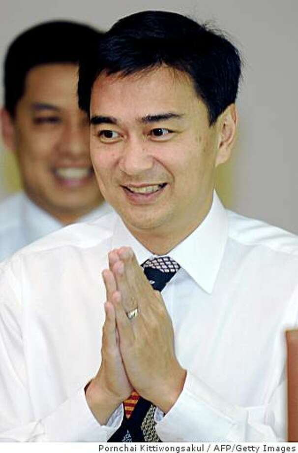Thai opposition Democrat Party leader, Abhisit Vejjajiva greets the press at the Democrat party in Bangkok on December 12, 2008.  Thailand's parliament will hold a crucial vote for a new prime minister on December 15, the speaker said, with the opposition set to take power in a new twist to a lengthy political crisis.  AFP PHOTO/PORNCHAI KITTIWONGSAKUL (Photo credit should read PORNCHAI KITTIWONGSAKUL/AFP/Getty Images) Photo: Pornchai Kittiwongsakul, AFP/Getty Images