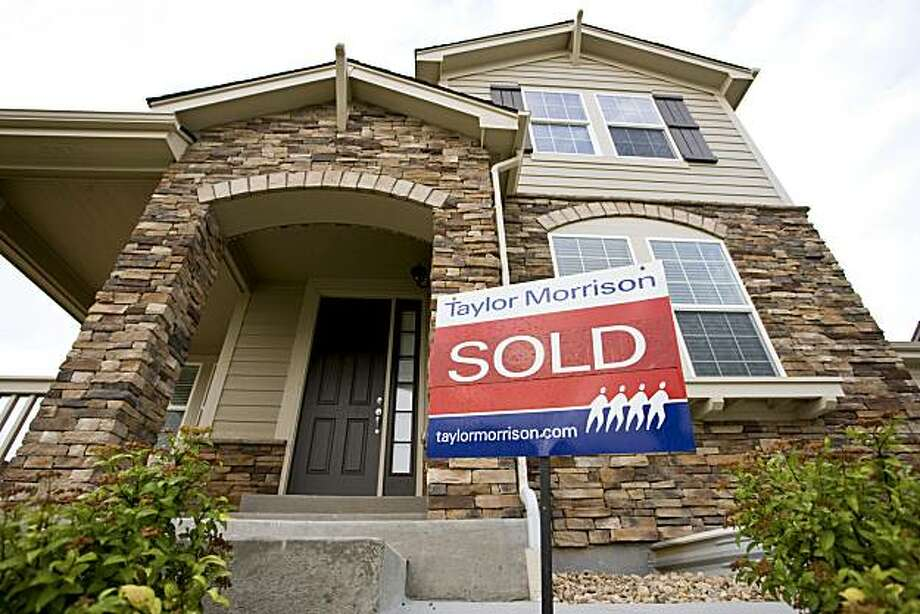 A sold sign stands outside a newly constructed single family home in Thornton, Colorado, U.S., on Tuesday, July 20, 2010. Housing starts fell in June to the lowest level since October as a slump in home sales following the expiration of a government tax incentive caused U.S. builders to cut back. Work began on 549,000 houses at an annual rate last month, down 5 percent from May. Photographer: Matthew Staver/Bloomberg Photo: Matthew Staver, Bloomberg