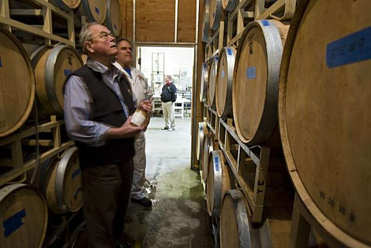 Fritz Maytag of The Anchor Steam Brewing and brewer/distiller Bruce Joseph check out barrels of Hotaling Whiskey during a tasting for local industry invited guest at the The Anchor Steam Brewing headquarter in San Francisco, California, Jun. 04, 2008. Photo By: Peter DaSilva/Special to the Chronicle