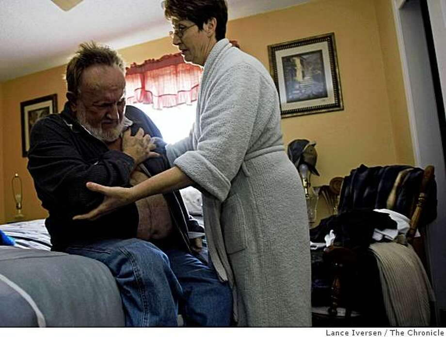 Alameda Briggs helps her husband Bennie out of bed. Six months after the couple moved into their Beachwood home in Merced 32 years ago Bennie started getting rashes all over his body. Bennie 67 has had skin cancer in the past and recently was diagnosed with lung cancer in the upper right lung. Photo: Lance Iversen, The Chronicle