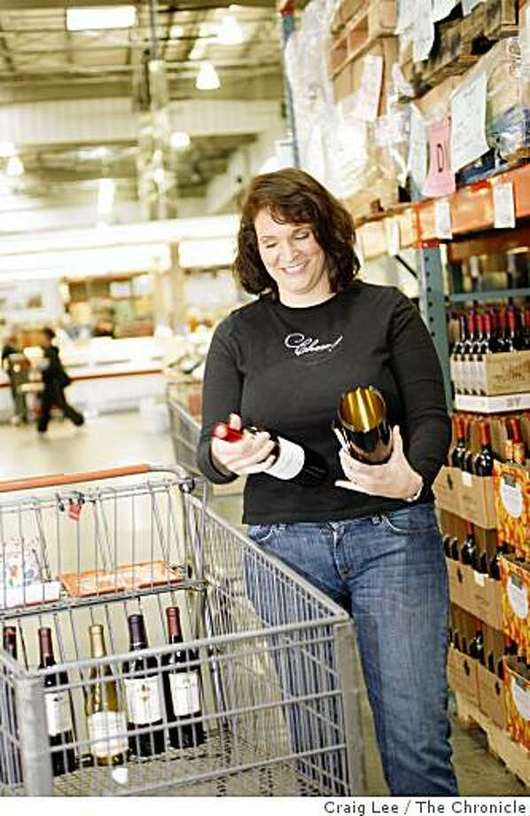 Kristyl Horton shopping for bargain wines at Costco in Richmond, Calif., on December 11, 2008. Photo: Craig Lee, The Chronicle