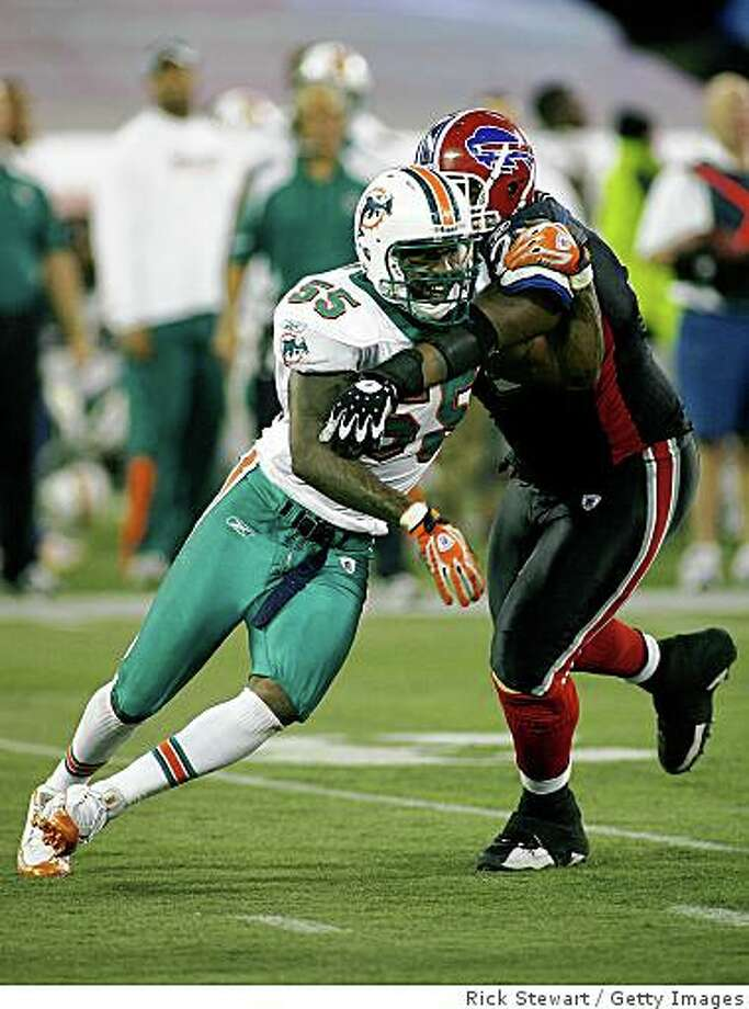 TORONTO, ON - DECEMBER 07: Joey Porter #55 of the Miami Dolphins gets around Jason Peters #71 of the Buffalo Bills  on December 7, 2008  at Rogers Centre in Toronto, Ontario, Canada. The Dolphins won 16-3.  (Photo by Rick Stewart/Getty Images) Photo: Rick Stewart, Getty Images