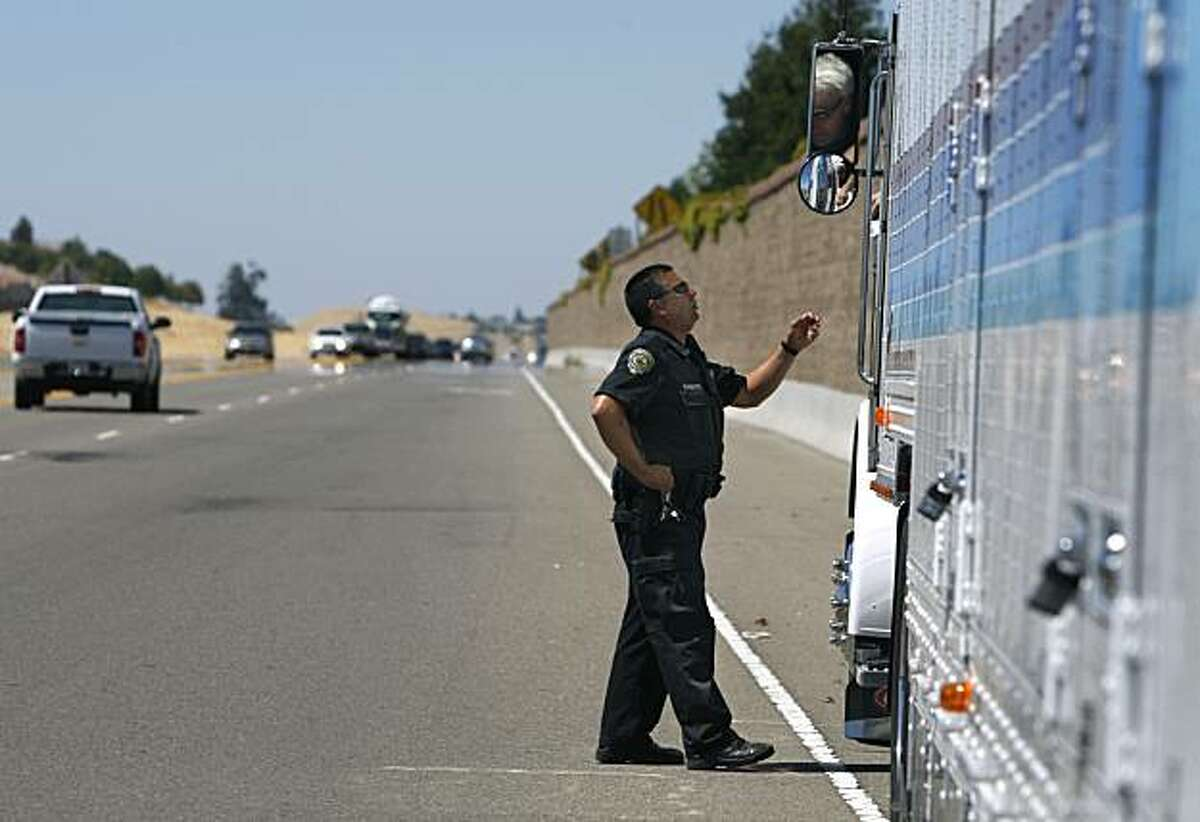 Police officer George Aguirre questions truck driver Brian Greif after pulling him over on Bypass Road in Brentwood, Calif., on Wednesday, July 21, 2010. Aguirre has been using a micro video camera attached to his uniform for over two years to record all of his activities.