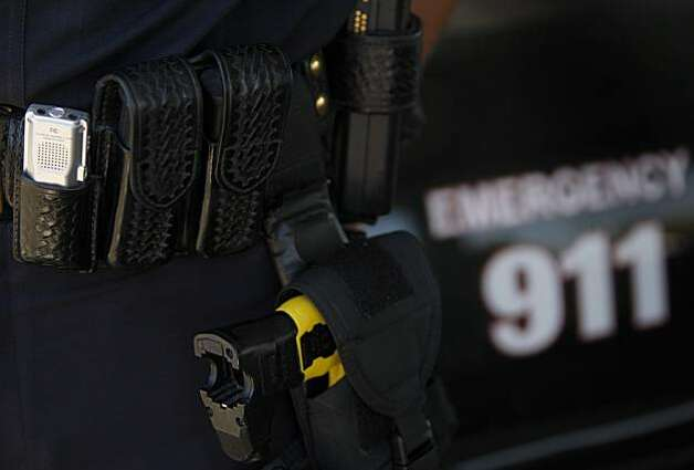 A digital voice recorder (left) is among the tools carried on police Lt. Tom Hansen's belt in Brentwood, Calif., on Wednesday, July  21, 2010. Hansen and many of the other police officers on the force record every voice conversation during with individuals or suspects. Photo: Paul Chinn, The Chronicle