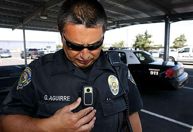 Brentwood police officer George Aguirre adjusts a digital video camera attached to his uniform before his traffic enforcement patrol in Brentwood, Calif., on Wednesday, July  21, 2010. Aguirre has been using the micro video recording gear for over two years. Photo: Paul Chinn, The Chronicle