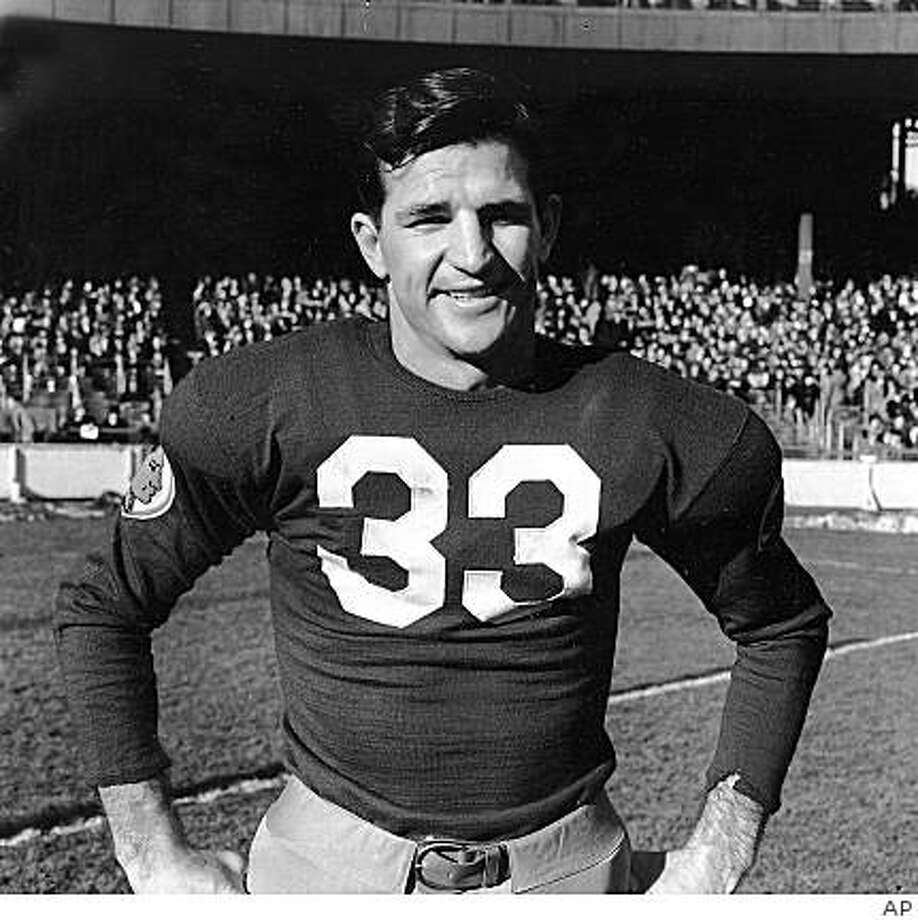 ** FILE ** In this Dec. 4,  1938 file photo, Sammy Baugh, quarterback for the Washington Redskins, is shown at the Polo Grounds in New York. Baugh, who set numerous passing records with the Washington Redskins in an era when NFL teams were running most every down, died Wednesday night, Dec. 17, 2008 his son said.  Baugh, who was 94 and had numerous health issues, died at Fisher County Hospital in Rotan, Texas, David Baugh said. (AP Photo, File) Photo: AP