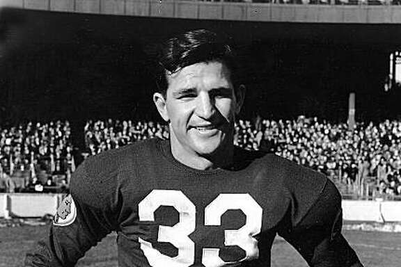 ** FILE ** In this Dec. 4,  1938 file photo, Sammy Baugh, quarterback for the Washington Redskins, is shown at the Polo Grounds in New York. Baugh, who set numerous passing records with the Washington Redskins in an era when NFL teams were running most every down, died Wednesday night, Dec. 17, 2008 his son said.  Baugh, who was 94 and had numerous health issues, died at Fisher County Hospital in Rotan, Texas, David Baugh said. (AP Photo, File)